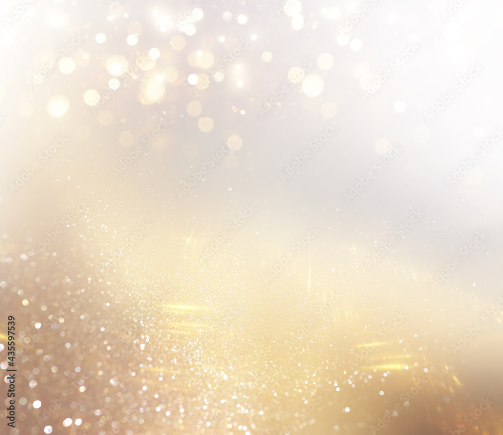 background of abstract gold and silver glitter lights. defocused