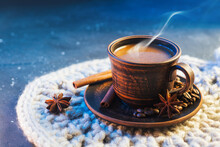 A Clay Cup Of Fragrant Hot Coffee On A Knitted Napkin, Roasted Coffee Beans , Cinnamon Sticks And Anise. Turkish Coffee