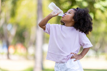 Concept Of Childhood And Drinking Water On A Hot Day.