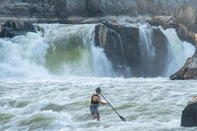 Ian Brown Stand Up Paddle Surfs Challenging Whitewater Below Great Falls Of The Potomac River, Border Of Maryland And Virginia