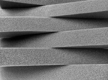 Crosswise Pile Of Gray Spongy Foam Material With Rectangular Pieces