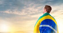 Brazilian Man With Brazilian Flag Looking At The Horizon