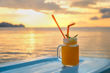Cocktails Or Juice From Fresh Tropical Fruits On The Background Of The Sea.