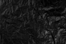 Background With Crumpled Black Paper Texture