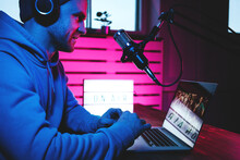 Streamer  Broadcasting His Live Audio Show At Home Studio Using Stylish Cyber Punk Blue Magenta Ambient Light