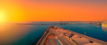 Panorama Of The Empty Terminals Of The Passenger Seaport In The Morning. Calm Sea And Sun Glare.
