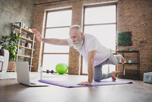 Full Length Photo Of Serious Focused Grey Haired Old Man Hold Plank Pilates Yoga Mat Look Laptop Indoors Inside House Gym