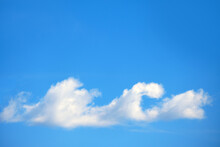 A Lone Cloud Like A Sea Wave, A Mirage In The Blue Sky