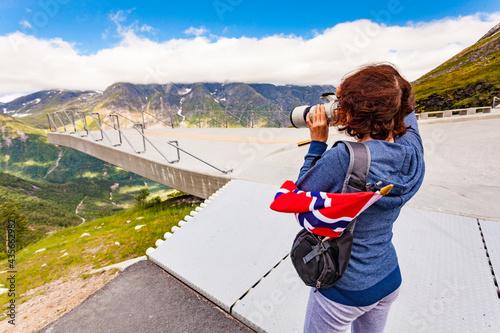 Obraz na plátně Tourist with camera on Utsikten viewpoint, Norway