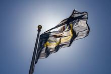 U. S. Navy Flag Against Blue Sky And Sunlight