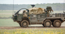 British Army Supacat Jackal MWMIK Rapid Assault, Fire Support And Reconnaissance Vehicle On Maneuvers In A Demonstration Of Firepower, Salisbury Plain Military Training Area