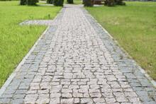 Granite Pavement. Footpaths With Granite Cobblestones