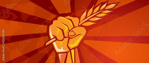 Fotografia hand holding grain wheat rice crop symbol of revolution fight for prosperity foo