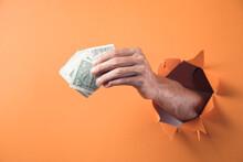 Hand Holds Money