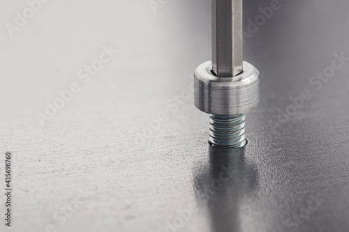 Fotografiet Hex wrench screw hex bolt in metal steel plate