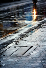 Wet Footpath On Rainy Day In The City,  View From The Level Of Asphalt.