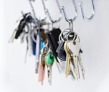 Close Up Of A Bunch Of Keys Hanging On The Hooks.