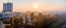 Panoramic Top Aerial View Of Modern City At Dawn