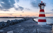 Sunset At The Lighthouse Of The Pier Of Peniche, Portugal