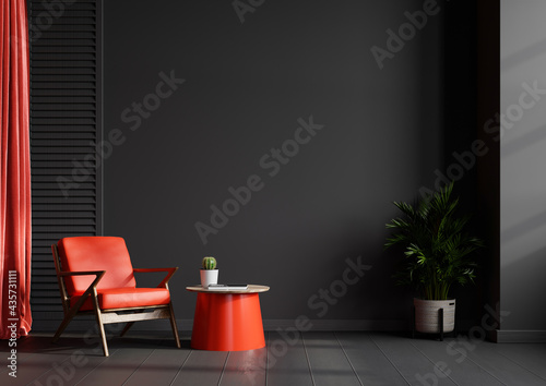 Living room interior wall mockup in black tones with red leather armchair on dark wall background.