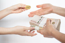 Cropped Shot Of People Hands Trading Bitcoin Token With Thai Baht Banknotes Isolated On White Background. Conceptual Shot Of Financial And Economic.