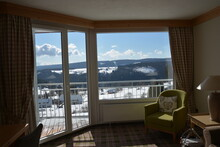 Stunning View Of Snow Covered Landscape And Cloudy Sky From Huge Panoramic Hotel Window