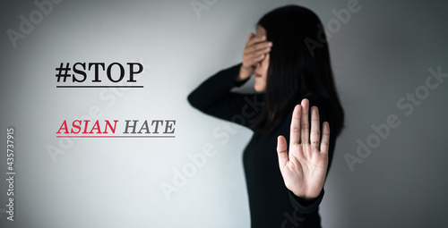 Woman showing hand stop with text stop asian hate,Racism against asian people ca Fototapet