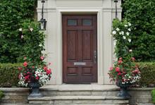 Elegant Dark Wood Grain Front Door With Vines And Flower Pots