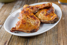 A View Of A Plate Of Baked Chicken Quarters.