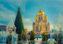 Beautiful Orthodox Church With Golden Domes And Christmas Tree