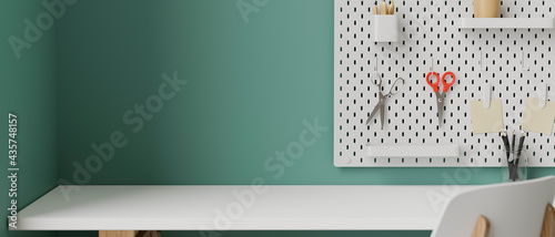 Stylish working space with white table, supplies, tools and stationery on shelf decorated on turquoise wall, 3D rendering