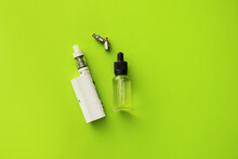 Vape Mod With Oil On Color Background