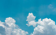 canvas print picture - White fluffy clouds on blue sky. Soft touch feeling like cotton. White puffy cloudscape. Beauty in nature. Close-up white cumulus clouds texture background. Sky on sunny day. Pure white clouds.