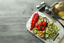 Concept Of Tasty Eating With Grilled Vegetables On Gray Textured Table