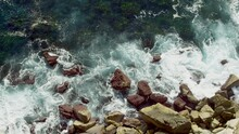 Waves Crashing On The Rocks From Shot From Above