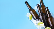 Party Refreshing Drink For Company. Full Dark Glass Bottles With Beer Or Lager Without Labels With Flowing Drops