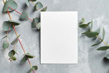 Stylish Wedding Invitation Card Mockup With Eucalyptus Branches On Grey Stony Background