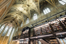Interior Of Dominican Church Converted Into A Bookstore With Restaurant, Customers, Cathedral Ceilings And Pillars Of The Church In Maastricht, Netherlands