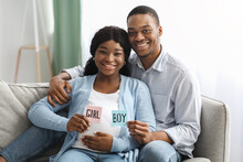 Positive Expecting Family Holding Colorful Cards Boy Girl
