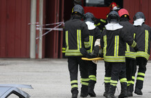 Firefighters Transport The Injured Person On A Stretcher After The Road Accident