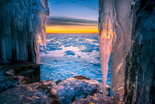 Ice Sculpture Mooring Post During Sunset In Winter At The Afsluitdijk In The Netherlands