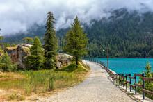 Narrow Pathway Along Lago Di Ceresole In Italy.