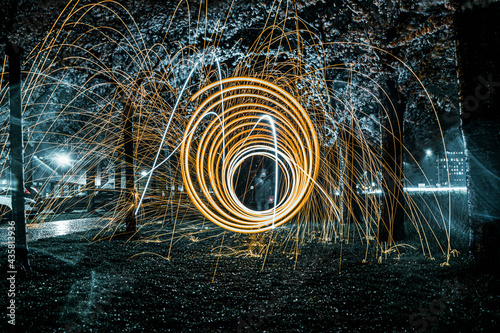 Canvas-taulu Steelwool photography in the park at rainy night