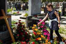 Girl Child Is Throwing Flower In Grave Of Deceased Person.