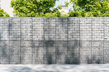 Rock Inside A Grid Fence In Abstract Style On Green Background. Rocks Inside A Metallic Frame. Mesh. Protection. Decoration. Home. Design