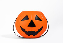 Jack O Lantern Orange Basket Or Bucket For Sweets Isolated On White Background With Shadow. Halloween Celebration And Trick-or-treating Concept. Sweets Collection Basket