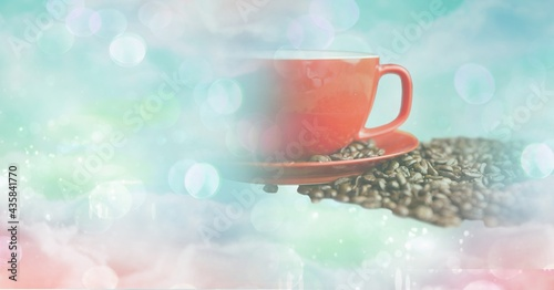 Composition of red cup and saucer with coffee beans with copy space