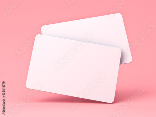 Fotografering Blank white business cards isolated on pink pastel color background with shadow