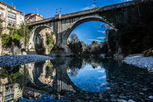 A 15th Century Stone Bridge Is Reflected In The Water Of The River Natisone That Crosses The Town Of Cividale In Northeastern Italy