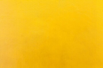 Cement wall painted yellow texture and background seamless